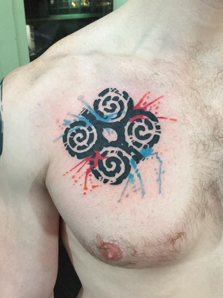 Red and Blue color Adinkra Tattoo on chest