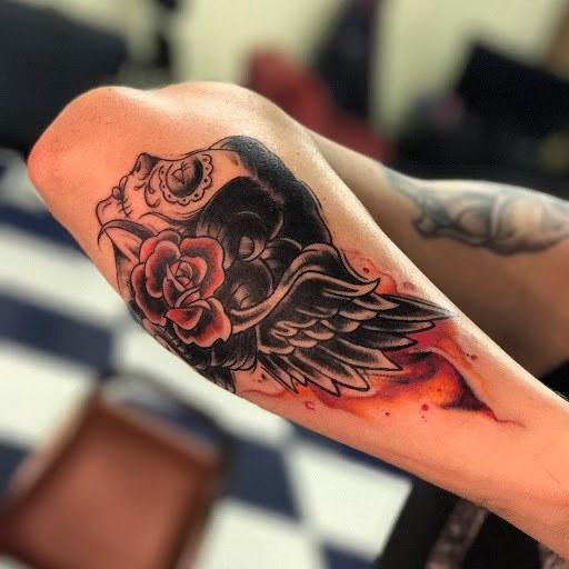 Gypsy Tattoo with skull on forearm