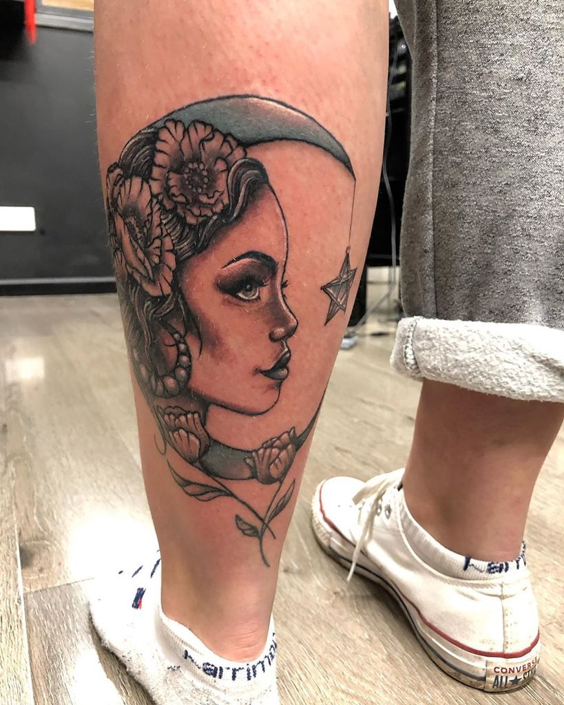 Gypsy Tattoo with moon on leg.