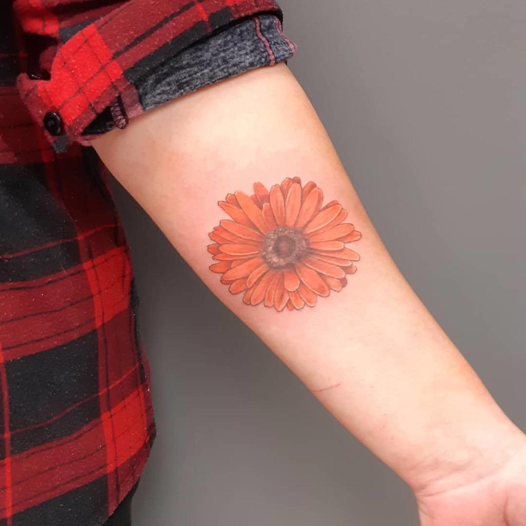 Beautiful Daisy Tattoo  for women on forearm