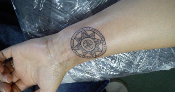 Star of Ishtar tattoo on wrist for women