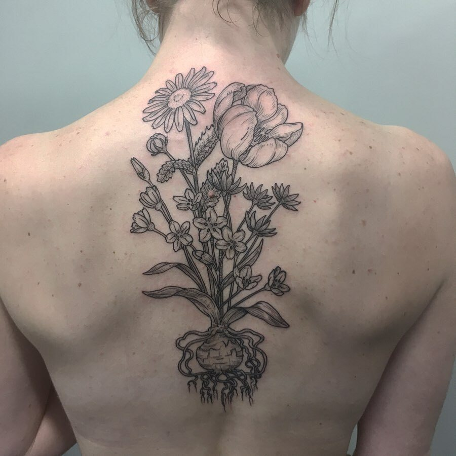 Daisy Tattoo at back for women