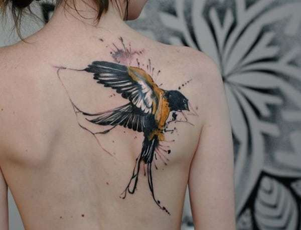 Big Swallow Tattoo at Back for women