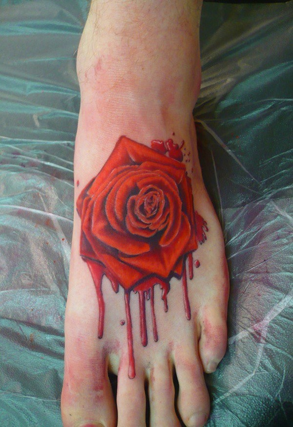 Bleeding rose Tattoo on foot