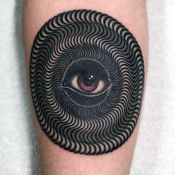 Circular design one eye tattoo