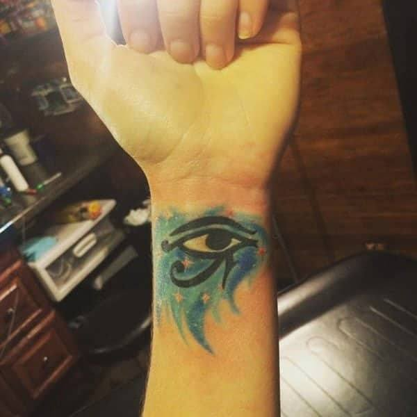 Water Color One Eye Tattoo on wrist for women