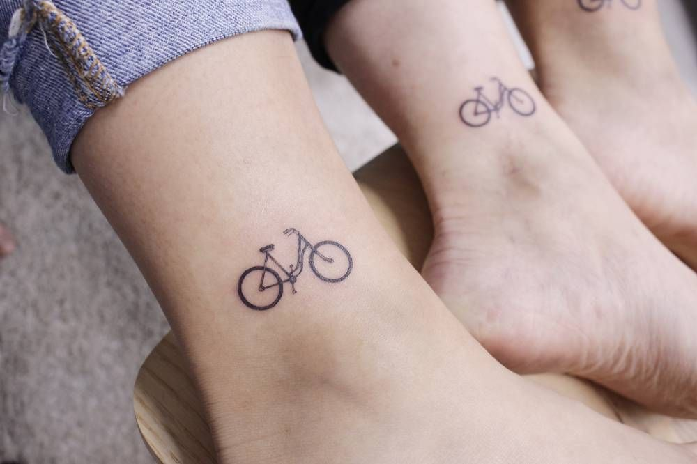 Cute small Cycle Tattoo on ankle for women