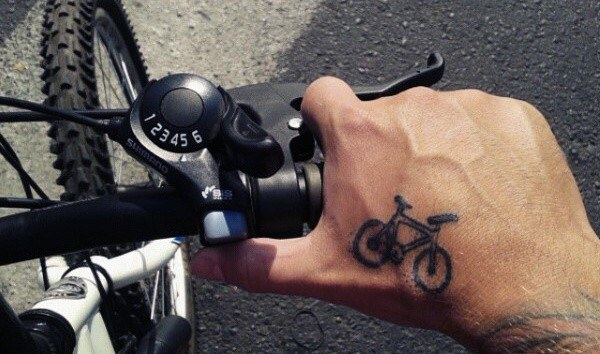 Tiny Cycle Tattoo on hand for men