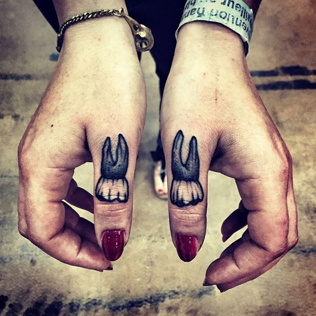 Tooth Tattoo on Finger for women