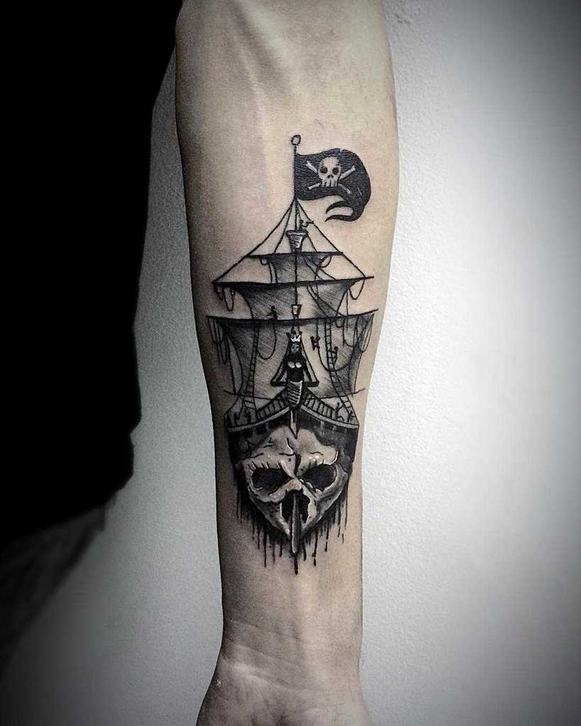Black and White Ship Tattoo with skull in forearm