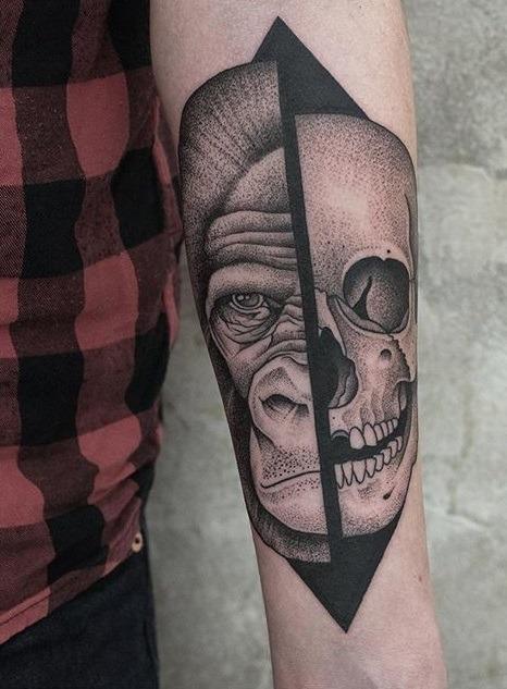 Ape Head with half skull tattoo on arm