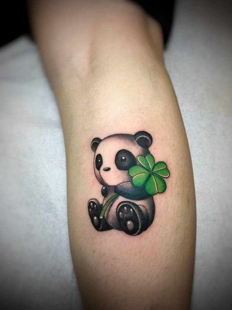 panda with leaf tattoo on forearm