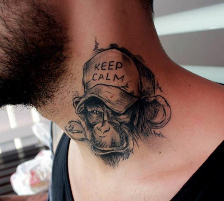 small sketch ape tattoo inner the collar bone for men