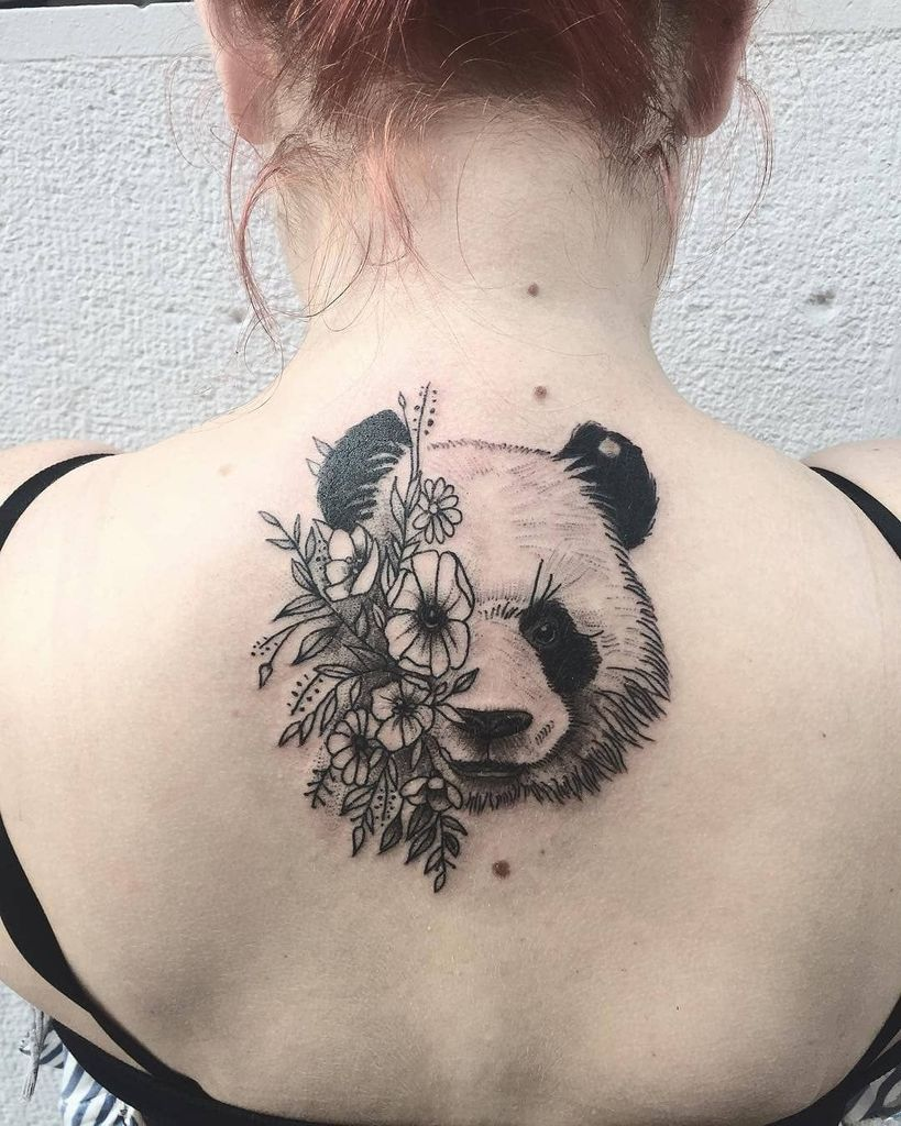 Panda face tattoo at back for women