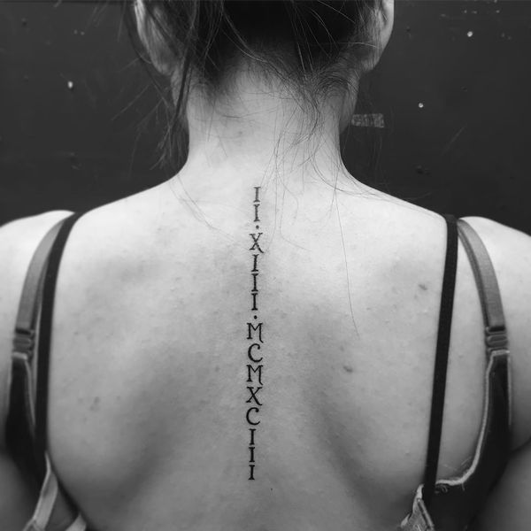 Roman Number Tattoo at back for women