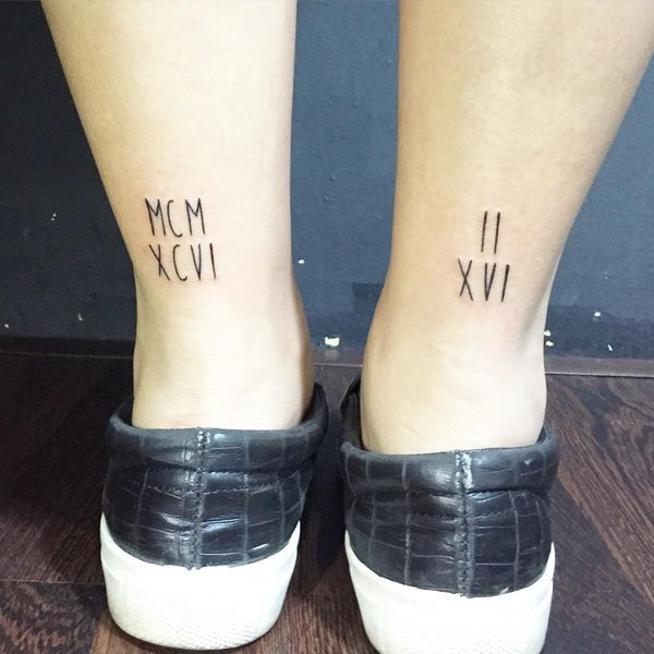 Simple Roman Number Tattoo on right and left leg
