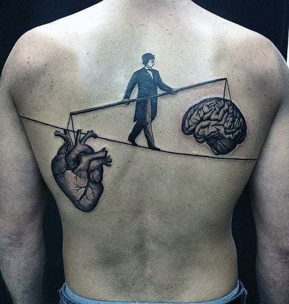 Brain and heart  balancing tattoo at back for men