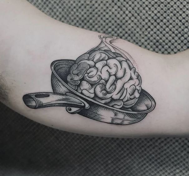Brain tattoo on bicep for men