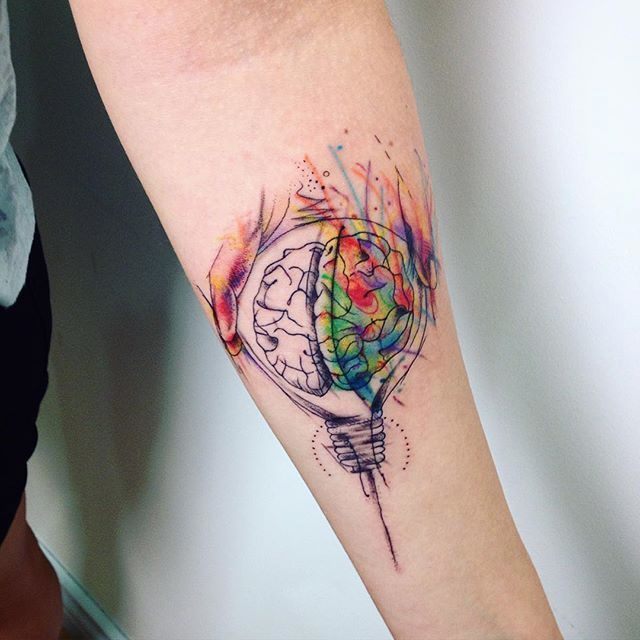 Brain tattoo with watercolor for women