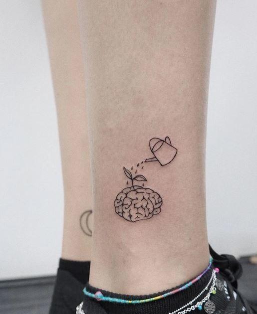 Tiny Brain tattoo on leg women