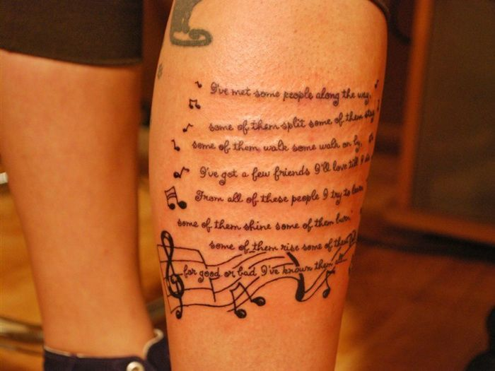 lyrics tattoo with notes on leg for men