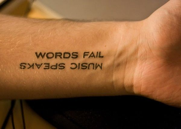 Bold song Letter Lyrics tattoo on wrist for men