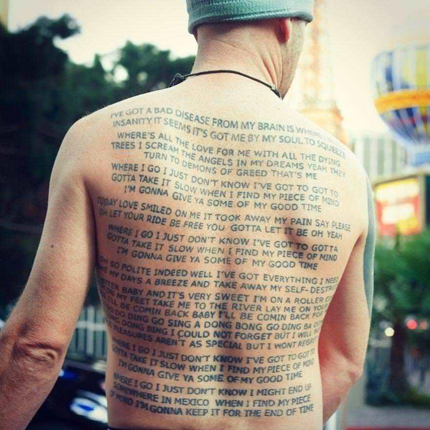 Song Lyrics tattoo at back body for men