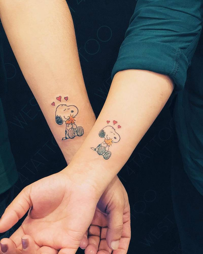 Snoopy Tattoo on wrist for couples