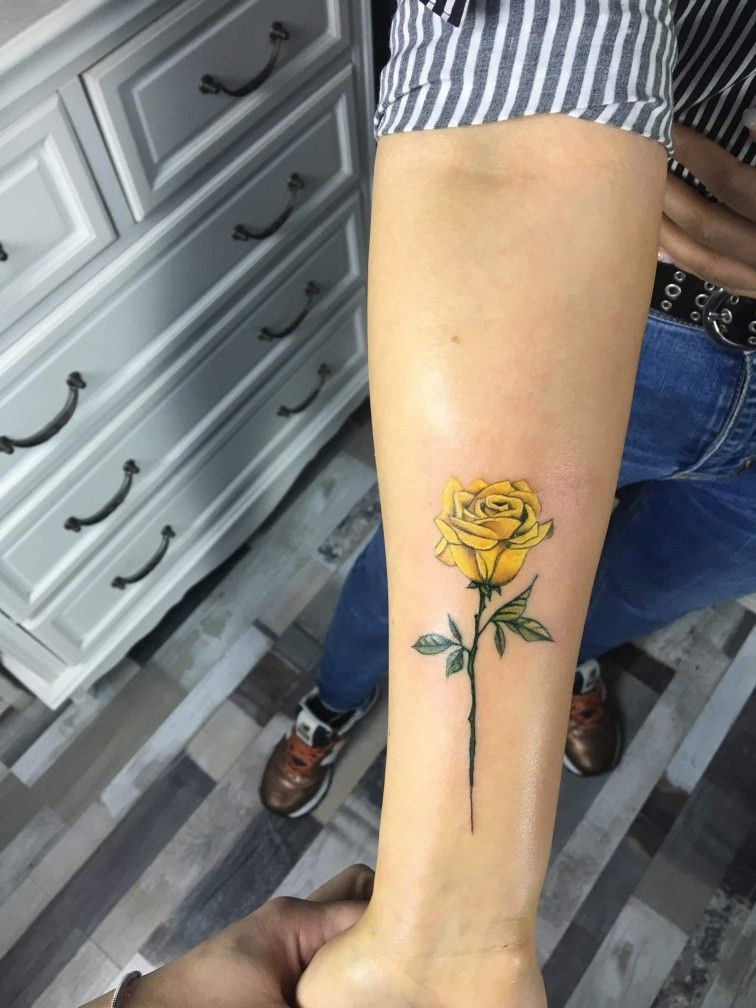 Yellow Rose tattoo with stem on hand