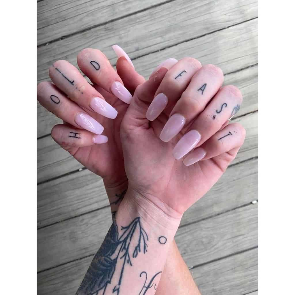 Classy Hold fast tattoo for women on finger