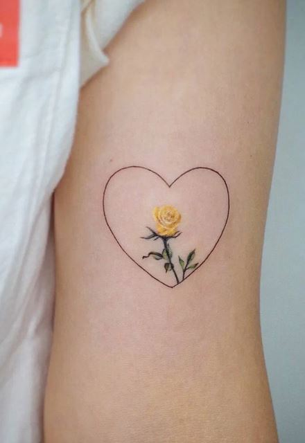 Yellow Rose Tattoo inside the heart shape