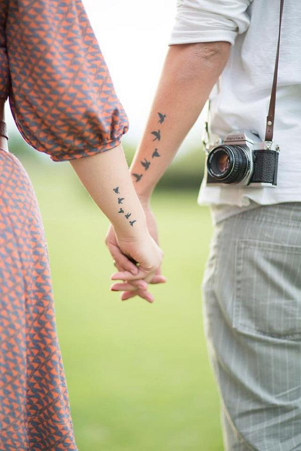 Cool birds Tattoo on hand for couple