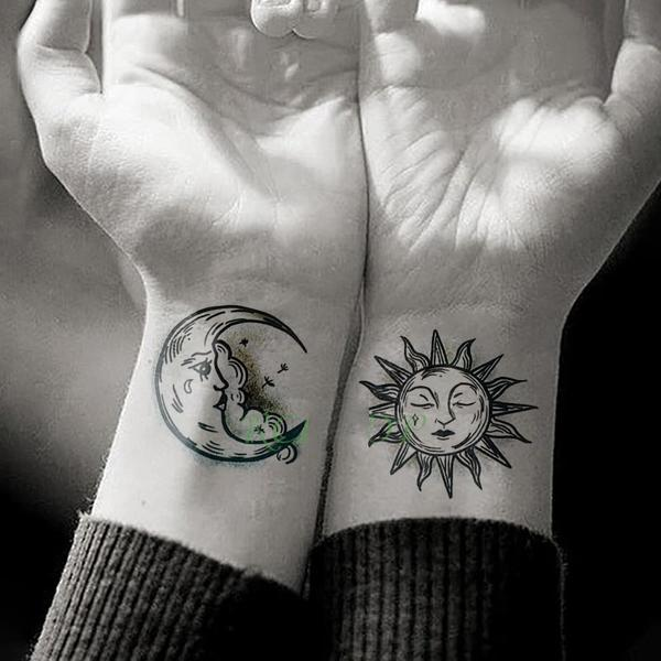 Sun and moon Tattoo on wrist for women