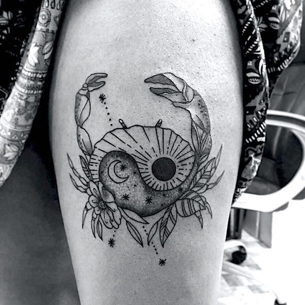 Black ink Cancer tattoo on shoulder for women