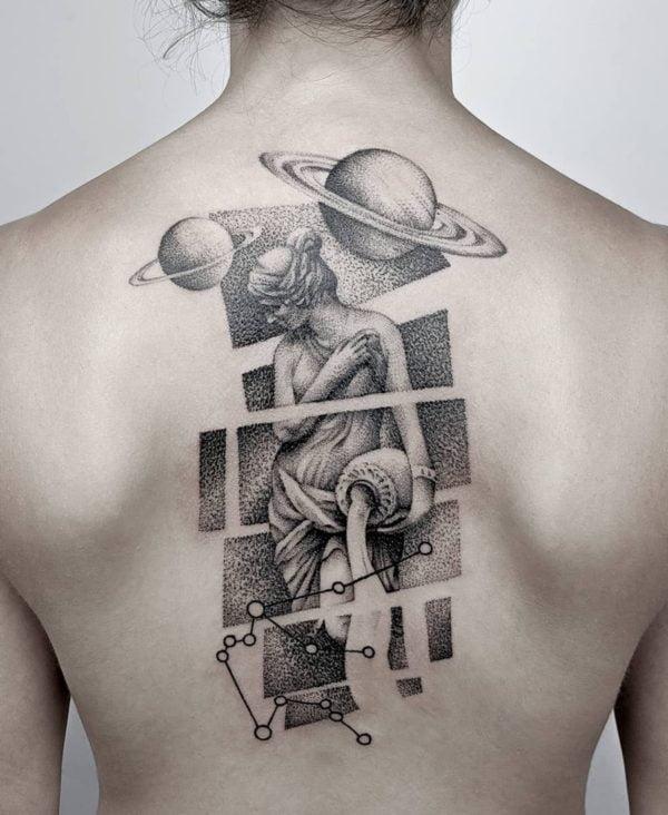 Bold Aquarius tattoo at back for women