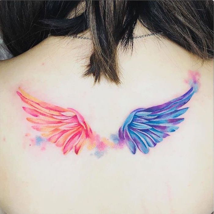 Colorful wings tattoo for women at back
