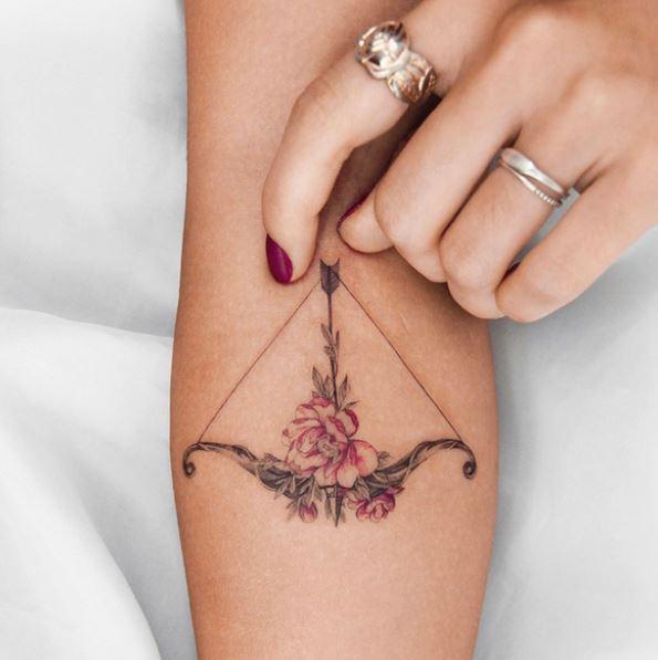 Sagittarius tattoo for women on forearm
