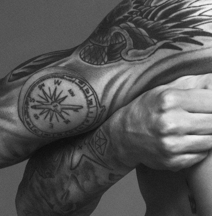 Justin Bieber compass Tattoo on hand