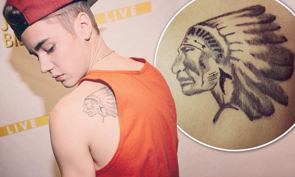 Justin Bieber Hockey tattoo at back
