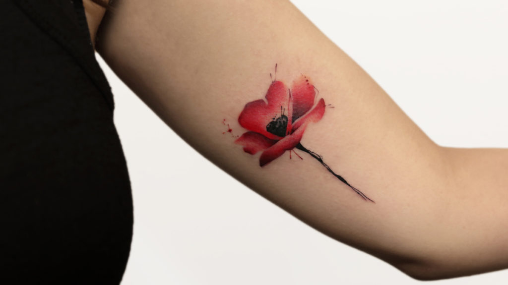 Classy flower tattoo for women