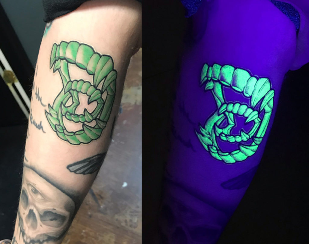 Black UV Light Tattoo on leg for men
