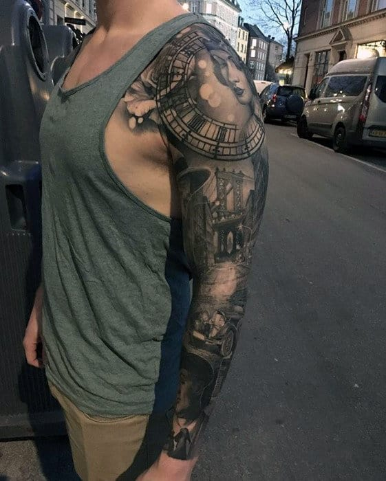 Realism tattoo about the past on shoulder for men